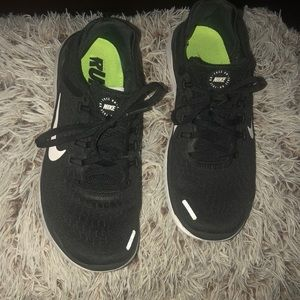 Nike run free running shoes size 7.5 black